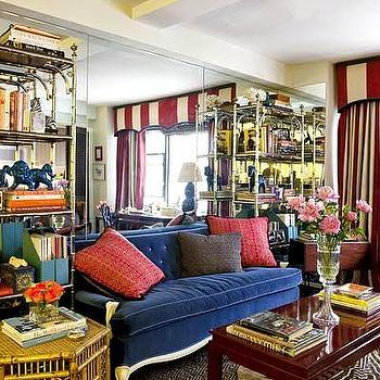 living rooms - tufted, sofa, tufted velvet sofa, tufted sofa, velvet sofa, blue velvet sofa, blue tufted sofa, striped valance, red coffee table, lacquered coffee table, red lacquered coffee table, mirrored accent wall, living room mirrored wall,