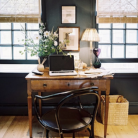 Lonny Magazine - dens/libraries/offices - farmhouse desk, farmhouse table, black walls, black office walls, rustic wood floors, Ernst Chair,