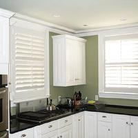 kitchens - green kitchen, white plantation shutters, white cabinets, black countertops, kitchen plantation shutters, plantation shutters,  kitchen