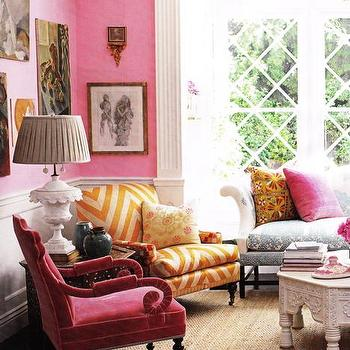 Windsor Smith Home - living rooms - accent chair, colorful throw pillows, pink walls, paint color, eclectic, living room, pink velvet chair, pink chair, velvet chair, chevron chair, gold chevron chair, wainscoting, living room wainscoting, vintage alabaster lamp,