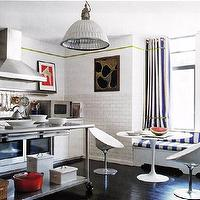 kitchens - grommet curtains, grommet drapes, striped curtains, striped drapes, striped grommet curtains, stripe grommet drapes, saarinen dining table, subway tiled walls, industrial kitchen island,