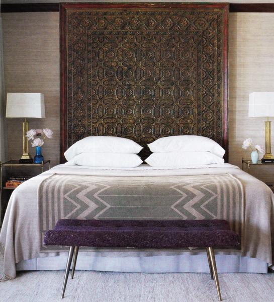 bedrooms - purple, gray, carved wood, Moroccan, headboard, gray geometric, cashmere, throw blanket, purple, tufted, bench, chrome, legs, brass, table, lamps, tiered, glass, brass, nightstands, beige, tan, brown, grass cloth, grasscloth, wallpaper, purple bench, purple tufted bench,