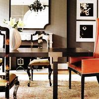dining rooms - dining room, taupe walls, taupe dining room, dining room fireplace, orange captain chairs, orange leather chairs, orange wingback chairs, orange and gray dining room, orange dining chairs,
