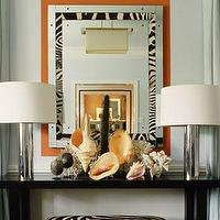 Mary McDonald - entrances/foyers - zebra mirror, black console table, foyer table, zebra bench,  Polished chrome column lamps, glossy black console
