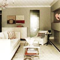 living rooms - silver, chandelier, abstract, art, white, glossy, lacquer, modern, cabinet, white, modern, sofa, chair, red, silk, damask, pillows, black, branch, accent, table, floor mirror, stainless steel, coffee table, glass top, wool, rug, gray, glass tiled, modern, fireplace, crown molding, gray walls,