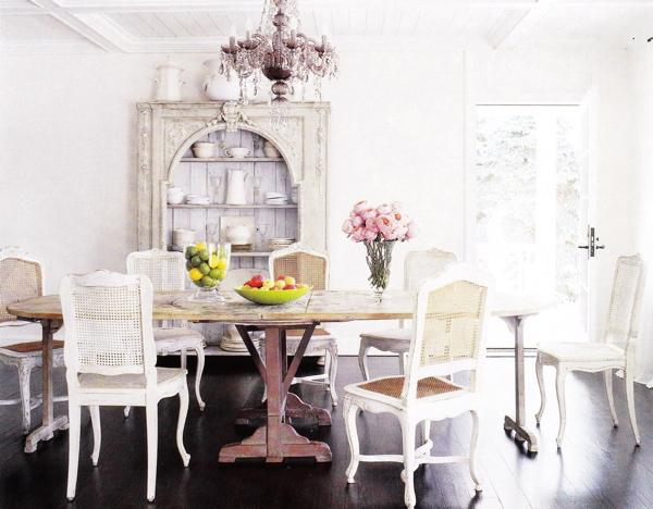 dining rooms - antique dining table white cane back French dining chairs antique white cabinet hutch pink crystal chandelier espresso wood floors French doors white pitchers molding dining room