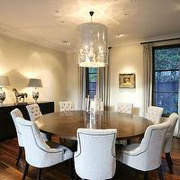 dining rooms - wood floors, gray walls, dining chairs, tufted dining chair, nailhead dining chairs, nailhead tufted dining chair, white dining chair, white tufted dining chair, dining table seats 10, round dining table seats 10, round dining table, oversized round dining table,