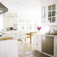 kitchens - white, carrara, carrera, marble, countertops, glass front, kitchen, cabinets, farmhouse, turned legs, rustic, dining table, white, dining chairs, yellow, stool, cushions, built-ins, hutch, tiles, French doors, warm, tiled, floors, kitchen,