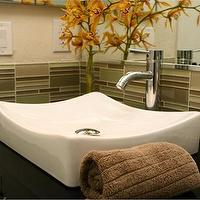 bathrooms - glass, tiles, vessel, sink,  glass tile  green glass tiles, white vessel sink, polished chrome faucet and orange accents.