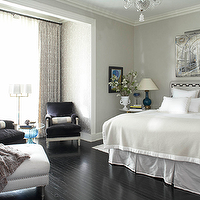 House Beautiful - bedrooms - gray, tufted, bench, nailhead trim, gray, velvet, headboard, charcoal gray trim, gray, bedskirt, bed skirt, charcoal gray, purple, accent chairs, gray, silk, bolster pillows, nightstand, tables, art, chandelier, blue, gourd, lamp, gray, chenille, throw, floor lamp, gray, silk, drapes, gray walls, gray bedroom,
