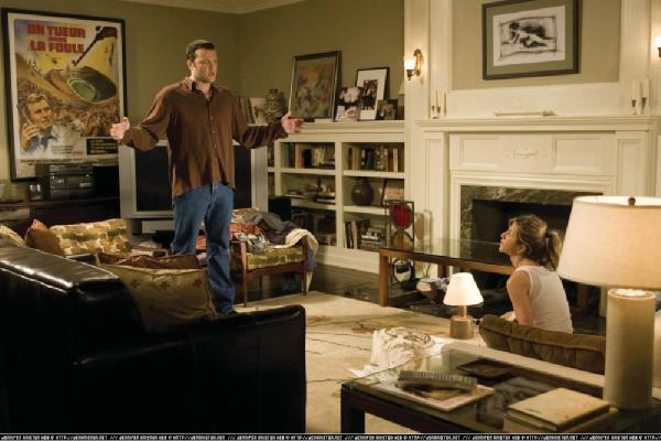 living rooms - bookshelves, fireplace, couch, rug,  Jennifer Aniston in The Break-Up.