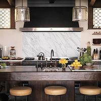 kitchens - beige, gold, leather, swivel, black, stools, espresso, brown, staines, wood, cabinets, island, white, carrara, marble, backsplash, glass, pendant, lighting, windows, slate, floors, black, painted, ceiling, kitchen,