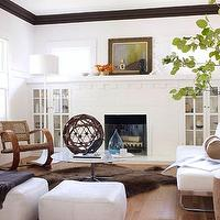 living rooms - modern, craftsman, home, brown, faux fur, rug, white, gray, marble, top, coffee table, white, leather, sofa, white, leather, square, ottomans, charcoal gray, cashmere, throw blanket, white, fireplace, built-ins, cabinets, wood, rocking chairs, rustic, wood, accent, tables, blue, vase, floor lamp,