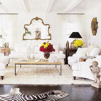 living rooms - white sofa, white chairs, white sofa and chairs, mismatched end tables, salvaged wood coffee table, cream rug, zebra rug, dark wood floors,