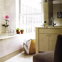 bathrooms - brown, velvet, chair, white, carrara, carrera, marble, countertops, tile, floors, ivory, cream, bathroom, vanity, chrome, faucet, sconces, modern, bathroom,