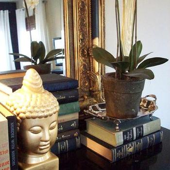 "Emily A. Clark - entrances/foyers - silver tray, bookends, gold bookends, buddha bookends, gilt frame,  Gold ""bookend"" and orchid were purchased"