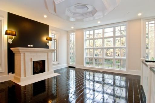 living rooms - espresso, brown, glossy, wood, floors, limestone, fireplace, black, accent, wall, silver, sconces, silk, black, lamp, shades, windows, living room,