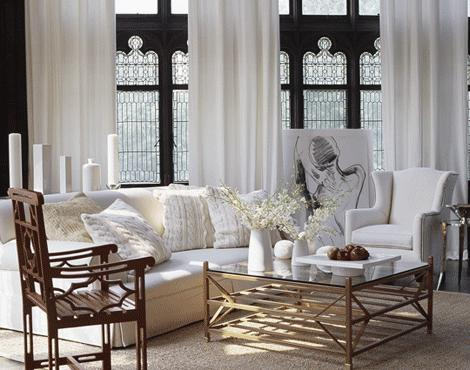 living rooms - brass tiered coffee table glass top sisal rug white wingback chair sofa wood chair white silk drapes lead glass windows black walls paint color living room
