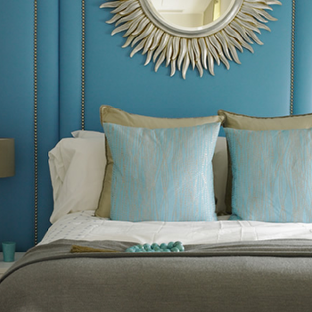 bedrooms - blue grey bedroom, blue gray bedroom, blue and grey bedroom, blue and gray bedroom, padded walls, turquoise padded walls, silver sunburst mirror, gray bedding, gray duvet, aqua pillows, walls with nailhead trim,