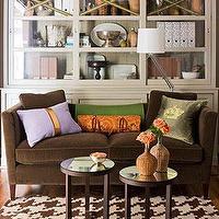 Living rooms brown velvet sofa purple orange green pillows