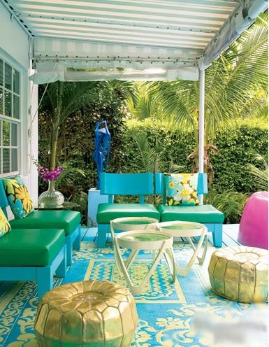 Gina Kates: Elle Decor - eclectic patio - covered patio deck, gold metallic pouf, yellow and blue ...