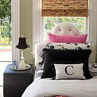 House Beautiful - girl's rooms - silk, white, tufted, headboard, bamboo roman shade, black, leather, cube, ottoman, pink, black, pillow, green walls, paint color, sisal, rug, girl's bedroom,