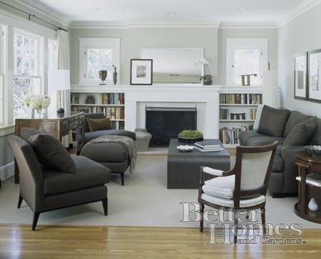 living rooms - gray ivory fireplace built-ins taupe sofa slipper chairs  BHG   love the soft gray walls, built-ins, dark furniture - airy/casual