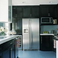 HGTV - kitchens - dark cabinets, white, glass tile,  love the white counter tops, glass tile backsplash