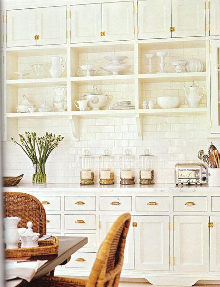 kitchens - white cabinets with brass pulls, white cabinets with brass hardware, white kitchen cabinets with brass pulls, white kitchen cabinets with brass hardware, open shelving, kitchen with open shelves, subway tile, subway tile backsplash, wicker dining chairs,