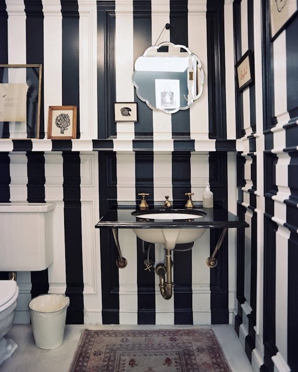 Lonny Magazine - bathrooms - striped powder room, powder room, vertical striped powder room, vertically striped powder room, white and navy striped walls, navy striped walls, wall mounted sink, black marble sink,