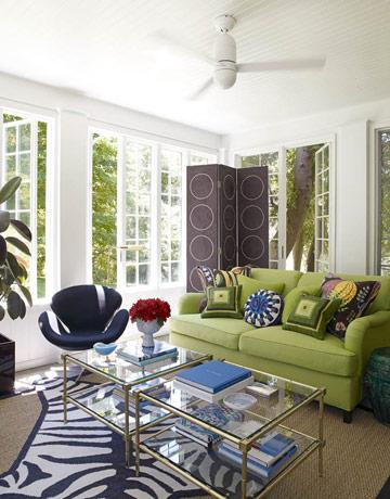 living rooms - Meurice 2 Tier Table Zebra Rug purple circles floor screen green garden stool navy blue white cowhide zebra rug gold faux bamboo tables blue accent chair sisal rug French windows white walls paint color living room