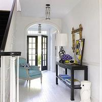 Jonathan Adler - entrances/foyers - entrance, foyer, plank floors, white plank floors, plank wood floors, white painted floors, black console table, owl umbrella holder, owl umbrella stand, bergere chair, turquoise bergere chair, Owl Unbrella Stand,