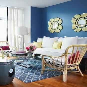 House & Home - living rooms - blue rug, trellis rug, blue trellis rug, white and blue living room, white sofa, acrylic coffee table, waterfall coffee table, yellow pillows, yellow mirrors, blue and yellow living room,