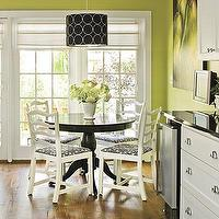 Southern Living - dining rooms - lime green, green walls, white cabinets, black granite, wood floors, roman shades, green walls, green paint, green paint colors, white and green kitchen, valspar greens, valspar green paint colors, black dining table white chairs, black dining table, white dining chairs, black drum pendant,