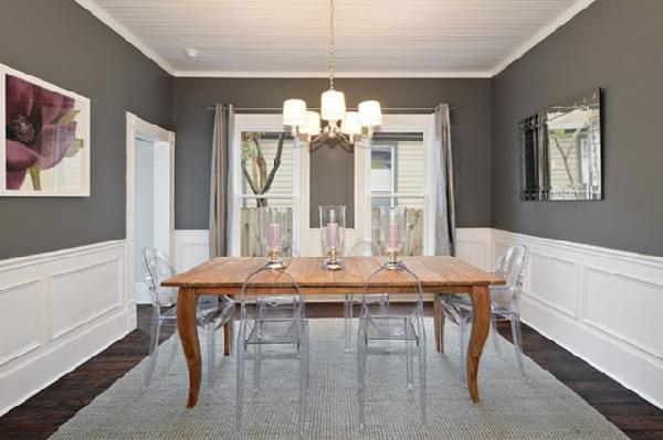 Avenue B - dining rooms - Benjamin Moore - Amherst Gray - dining room, charcoal, gray, purple, picture molding, acryclic, chandelier, mirror, table, chairs, rustic table, clear chairs, beadboard, charcoal gray walls, charcoal gray paint, charcoal gray paint color, charcoal gray dining room walls, charcoal gray dining room paint, charcoal gray paint color,