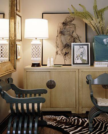 living rooms - chinoiserie cabinets, hollywood regency lamp, nude sketch, zebra rug, gold leaf mirror, gold beveled mirror, gold leaf beveled mirror,