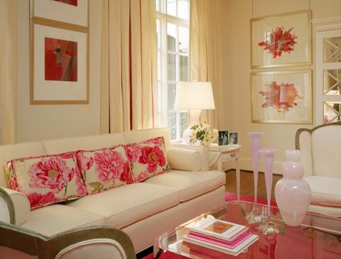living rooms - ivory sofa pink floral pillows pink rug gold  Pretty in pink  white sofa, pink floral pillows, acrylic lucite coffee table