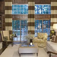 Pineapple House - media rooms - striped floor to ceiling window treatments, ivory, paisley print, ottoman, rocker, stone fireplace, striped curtains, horizontal striped curtains,