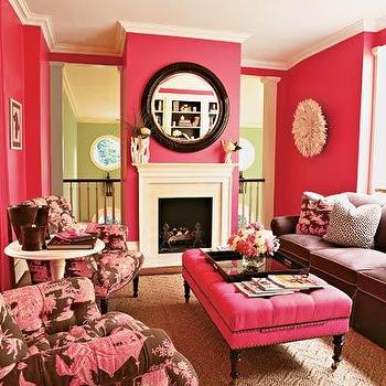 House Beautiful - dens/libraries/offices - pink ottoman, pink tufted ottoman, hot pink ottoman, hot pink tufted ottoman, ottoman on caster legs, pink ottoman with nailhead trim, pink living room, pink and brown living room, brown sofa, pink and brown sofa, rolled arm sofa, brown rolled arm sofa, pink and brown chairs, rolled arm chairs, pink and brown rolled arm chairs, pink walls, white juju hat, hot pink walls,