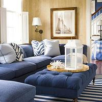 living rooms - navy blue sofa, navy blue sofa, navy sectional, navy blue sectional, navy sectional sofa, navy blue sectional sofa, navy tufted ottoman, navy blue tufted ottoman, striped rug, navy striped rug, white and navy striped rug,
