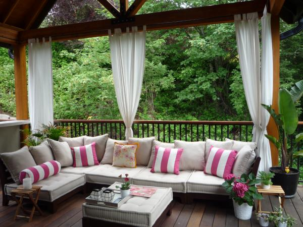 decks/patios - outdoor sectional, exterior curtains,  Outdoor living space  white and pink striped pillows and outdoor furniture.