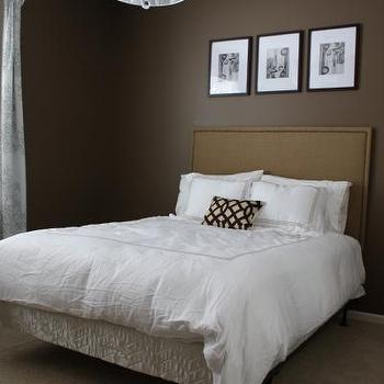 bedrooms - brown walls, brown paint, brown paint color, brown colored walls, brown colored paint, linen headboard, nailhead headboard, , Urban Outfitters Rug, Chrome and White 6-light Crystal Chandelier,