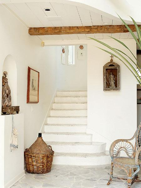 Sunset Magazine - entrances/foyers - white stairs, white staircase, foyer niche, arched niche, arched foyer niche,  Exposed wood beams and basket
