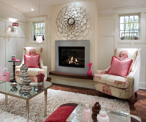 Brandon Barre Photography - living rooms - family room, basement family room, basement fireplace, family room fireplace, upholstered chairs, swoop arm chairs, mirrored top coffee table, pink pillows, pink ruffled pillows,