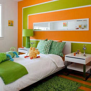 Brandon Barre Photography - boy's rooms - orange and green kids room, orange and green boys room, orange and green boys bedroom, green grass rug, green throw, green throw blanket, apple green throw, green and orange walls, modern nightstands, green lamps, green pillows, striped floor,