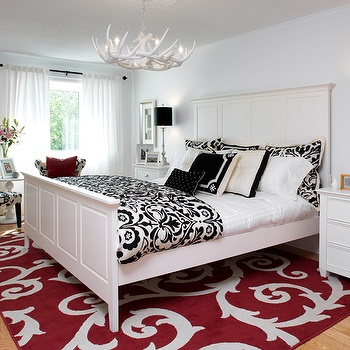Brandon Barre Photography - bedrooms - damask duvet, damask shams, black and white duvet, black and white shams, black and white damask duvet, black and white damask shams, damask bedding, black and white damask bedding, white wood bed, white wood headboard, white and red rug, rug under bed, scroll rug, red scroll rug, white nightstands, white antlers chandelier, faux antlers chandelier, Antler Chandelier,