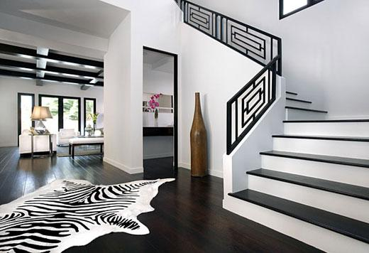 entrances/foyers - Zebra Cowhide Rug, dark wood floors, square modern iron railing, iron stair railing, black stair railing, stair railing, zebra rug, zebra cowhide rug, geometric stair railing,