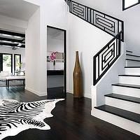 entrances/foyers - dark wood floors, square modern iron railing, iron stair railing, black stair railing, stair railing, zebra rug, zebra cowhide rug, geometric stair railing, Zebra Cowhide Rug,
