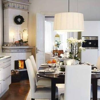 dining rooms - corner fireplace, dining room fireplace, parsons  dining chairs, white dining chairs, pleated drum pendant,  white and gray dining