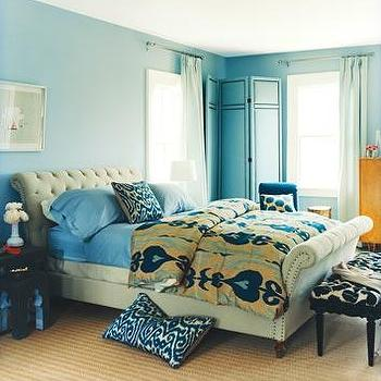 Domino Magazine - bedrooms - sleigh bed, velvet sleigh bed, tufted sleigh bed, turquoise sheets, turquoise blue sheets, ikat duvet, ikat bedding, turquoise floor screen, turquoise blue floor screen,